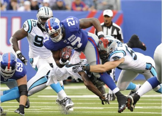 New York Giants running back Brandon Jacobs (27), center, is tackled during an NFL football game against the Carolina Panthers at New Meadowlands Stadium in East Rutherford, N.J., Sunday, Sept. 12, 2010. (AP Photo/Henny Ray Abrams) ASSOCIATED PRESS