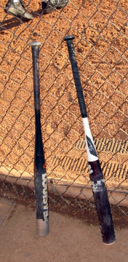 DeMarini on the Right and my Old TPS Louisville on the Left