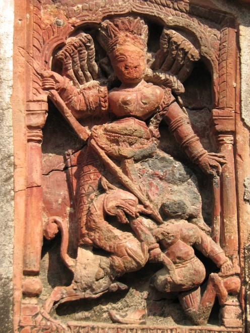 An unusual panel depicting Mahishamarini Durga from Baronagar temples. Notice the ornate ears of the lion.