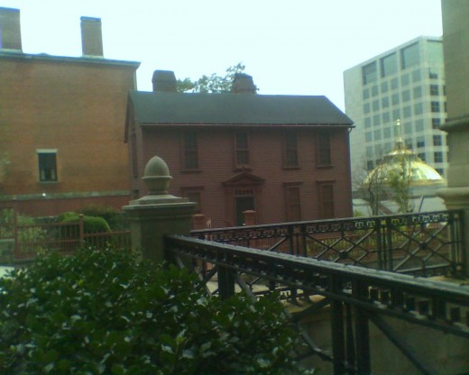 Variety of Architecture: Old house near a golden dome