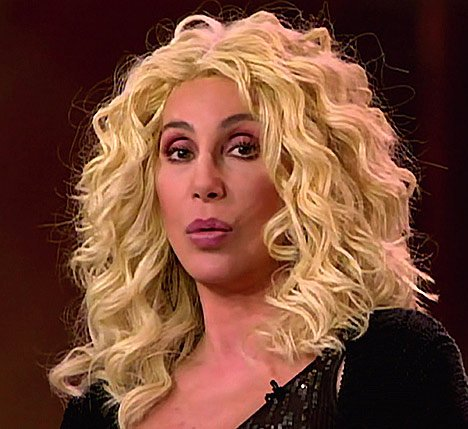 Cher with absurd looking blonde hair.