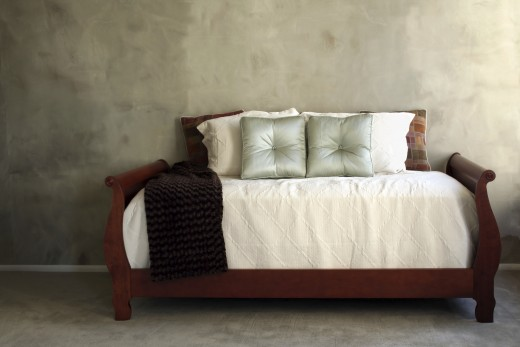 A daybed - not quite a bed, not quite a couch. Your daybed bedding should reflect that.