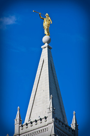 On top of the tower of the Salt Lake Temple can be seen the Angel Moroni.  Picture taken by Aaron Baker Photography
