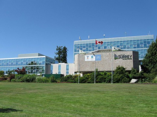 This is a north facing view of the present City of Surrey municipal hall where the local civic leaders work. It is located at 14245 56 Avenue in Surrey, British Columbia, Canada. This picture was taken on Canada Day (July 1) in 2009. (Uploaded by Leo