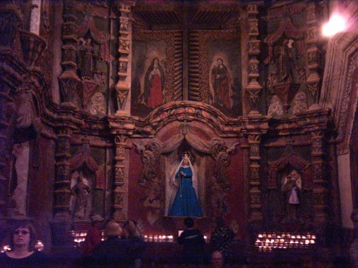 Altar in Chapel to right of Main Altar in the 18th Century Mission Church of San Xavier del Bac in Tucson, AZ