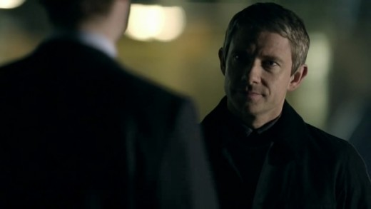 John Watson (Martin Freeman) speaks with a mysterious stranger.