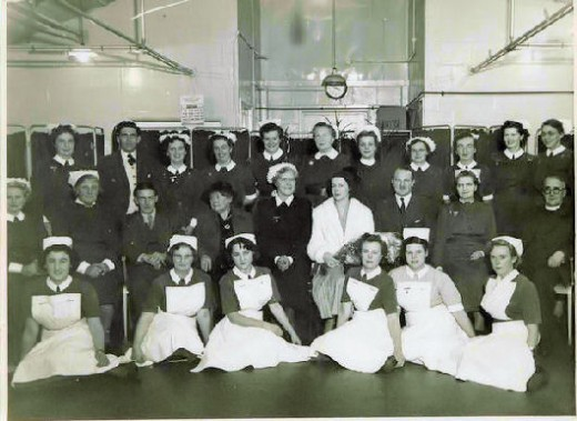 An official-type photo of hospital staff in the 1950s