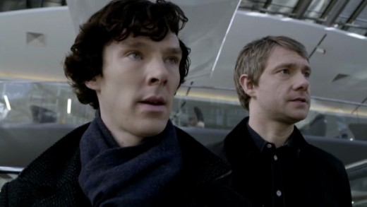 Sherlock Holmes (Benedict Cumberbatch) and John Watson (Martin Freeman) at the exchange.