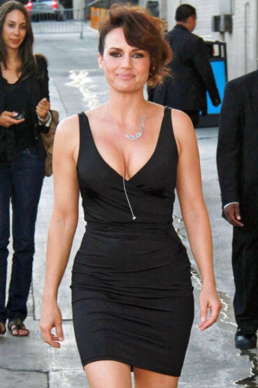 Carla Gugino in a black mini dress