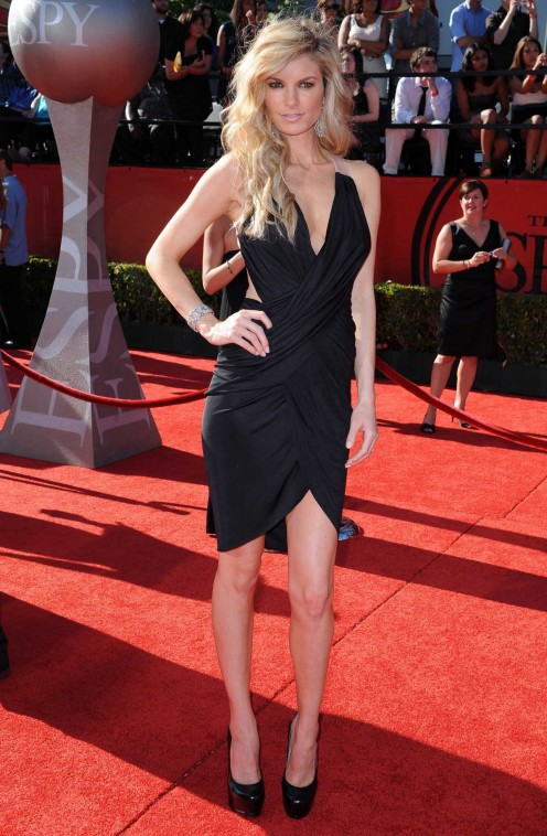 Marissa Miller on the red carpet in a low cut little black dress