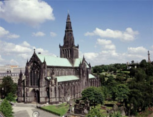 Glasgow Cathedral with the Necropolis graveyard on the hill in the background.