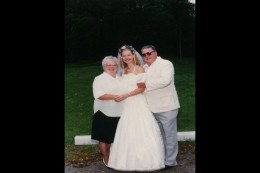 Mom and Hank with my oldest niece on her wedding day.