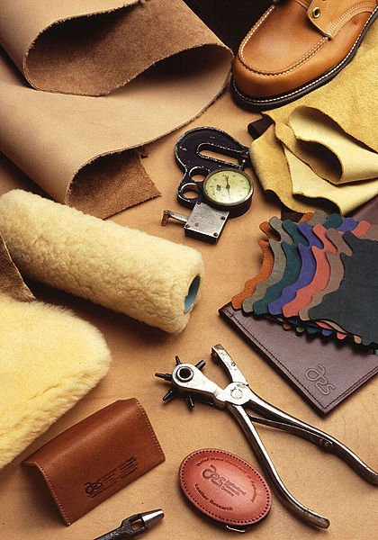 A variety of leather goods and leatherworking tools.