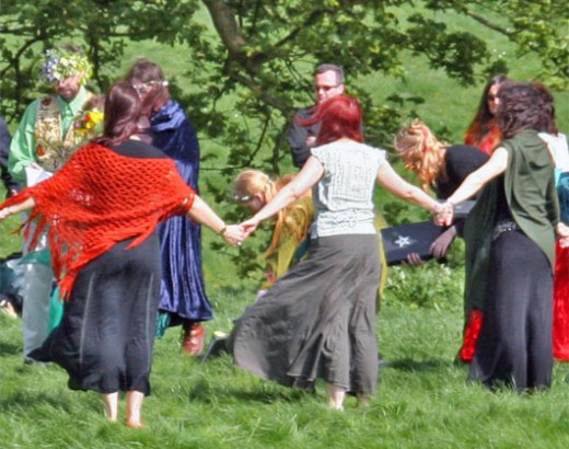 Photograph of a pagan handfasting in progress.  Used under the Creative Commons License Attribution Share Alike 2.0 License and was provided by the ShahMai Network
