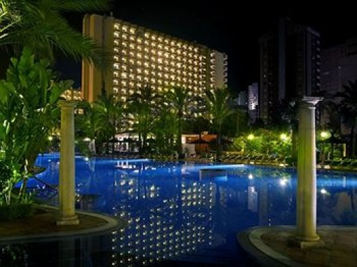 view of the pool at Hotel Sol Pelicanos, Benidorm, at night-time