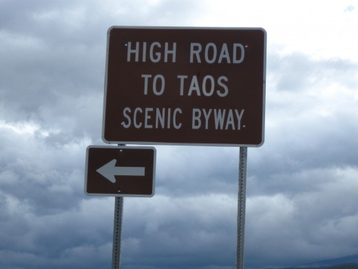 Sign pointing was to scenic High Road to Historic Taos, New Mexico