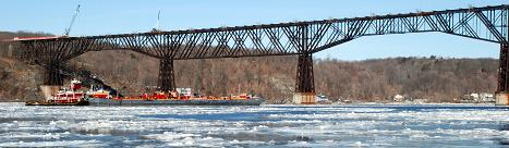 A photo of the Poughkeepsie Railroad Bridge in early spring. This was one of the first warm days of the year when the ice in the Hudson River began to melt.