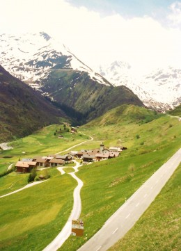 Groupings of homes seen scattered throughout the mountainous region.