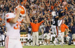 Auburn players celebrate as Clemson kicker misses a field goal that would have tied the game in overtime.