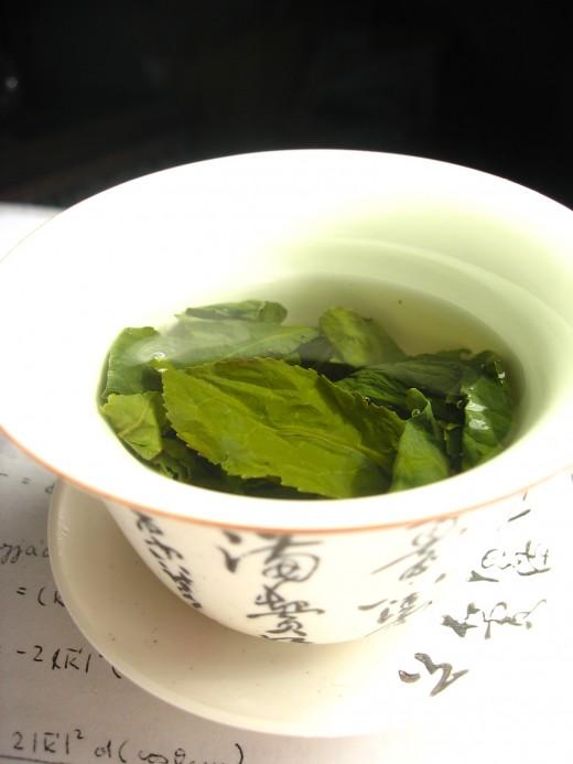 Green tea leaves, steeping