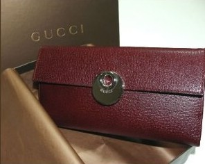 Buy a Gucci leather checkbook wallet