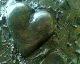 "Smaller heart embedded in one of the two ""Two Big Black Hearts"" by Jim Dine"