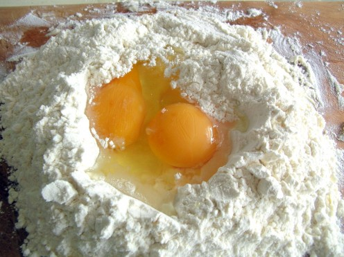 Add eggs in a hollow made in the flour