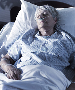 A coma patient. Clinical sign of the severe stage of Diabetes