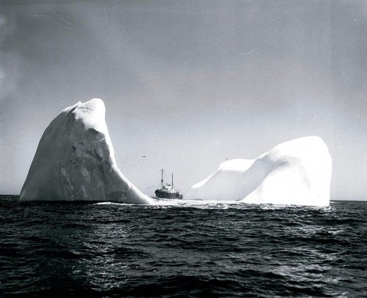 Berg and Coast Guard ship.  Image courtesy Wikimedia Commons.