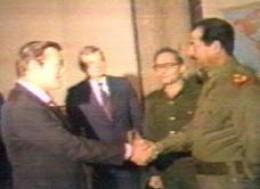 Donald Rumsfeld networks with Saddam Hussein
