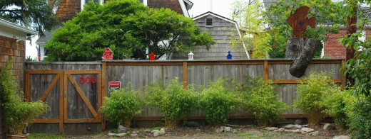 A whimsical back yard fence - private, but with a sense of humor