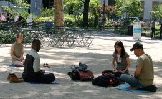New Yorkers meditating in Madison Square Park.