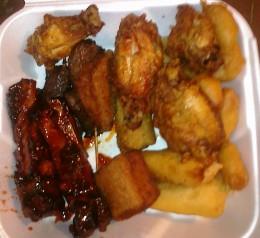 Pu Pu Platter appetizers mixture of 2 egg rolls, 2 Chicken wings, 2 spare ribs, 2 shrimp toast, 2 jumbo shrimp, 6 Chicken fingers, 2 teriyaki Beef