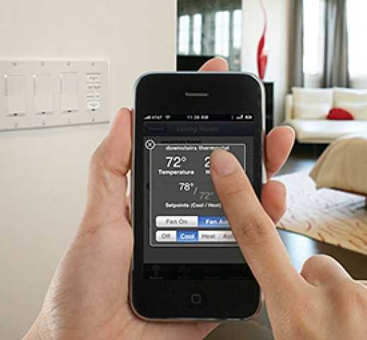 Using iPhone to control thermostat | image credit: SmartHome
