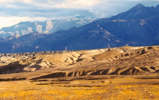 The colors of the mountains and sand dunes vary by the time of day and lighting.
