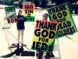 According to one of the signs, God punished America with 9-11 because we tolerated gay people. At last, we have another idea of who the terrorist was that took down the WTC.