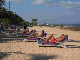 Enjoying the sun at Nusa Dua Beach, Bali