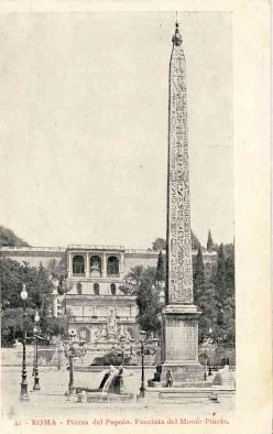 An Egyptian obelisk of Ramesses II from Heliopolis stands in the centre of the Piazza. In the background is the triple-arched nymphaeum on the Pincio designed by architect Giuseppe Valadier in 1811 to 1822.