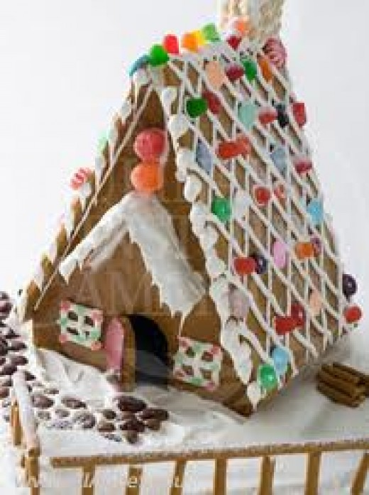 Royal icing is great to use as 'glue'.  Gingerbread houses are excellent for showing off your edible glitter colors also.