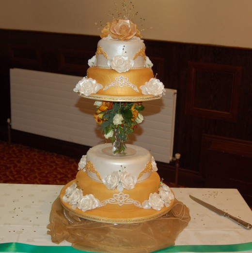 A Celtic themed, 4 Tiered Wedding Cake with sugar roses.