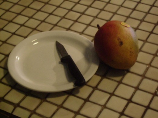 Ready to start with my mango, sharp knife and plate.