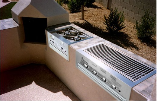 lazyman builtin bbq grill lm 210-40 and the lm 210-30 built in side burners in a custom outdoor summer kitchen.