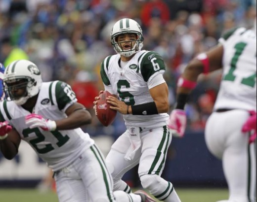 New York Jets quarterback Mark Sanchez (8) passes against the Buffalo Bills during the first half of an NFL football game in Orchard Park, N.Y., Sunday, Oct. 3, 2010. (AP Photo/Mike Groll)