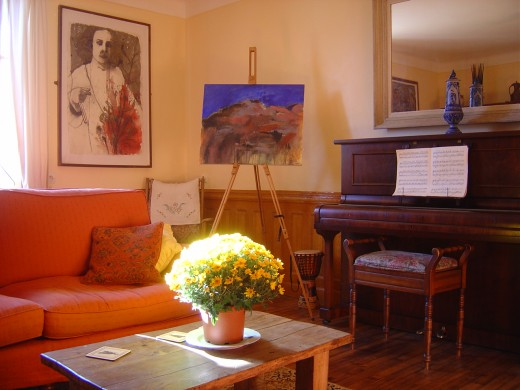 This is our living room and you are welcome to share it with us. We have a piano, computer, TV, video, CD player. WIFI available