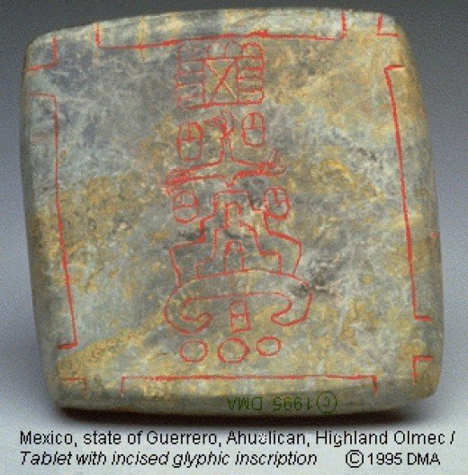These ancient incised glyphs are associated with the Olmec and bear some similarities to Maya glyphs.