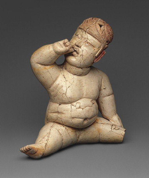 Here is another action figurine carved by an ancient Olmec artist. There are a large number of such carvings in many materials.