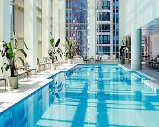 Beautiful blue waters and tall ceiling and expansive window with the Swimming Pool at the Peninsula Hotel Chicago
