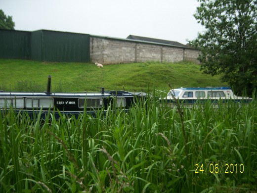 Large Farm on way to Bosley Locks - plus lots of moorings with barges