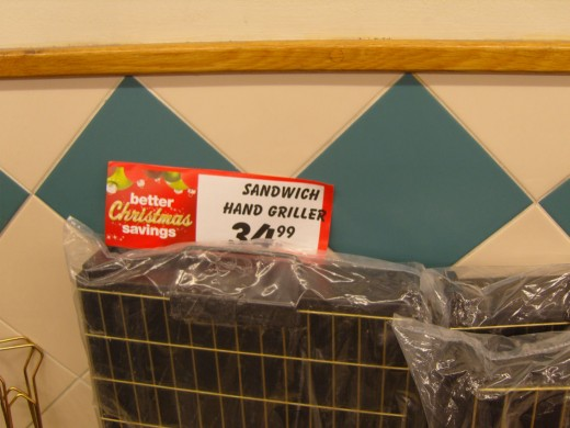 Grilled hand - must be a new and previously unheard of delicacy here in South Africa? I somehow think that the signage should have read 'bbq or braai sandwich type griller.'