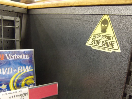 "Seriously, how do they expect the general public to ""Stop Piracy"" when blank CD's and DVD's are right there next to the signage in question? Mind you, these devices apparently do make wonderful coffee cup coasters and  sun catchers as well :P"